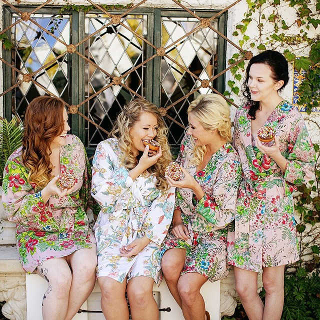 Sweet bridesmaids, donuts, and gorgeous @plumprettysugar robes = a perfect way to start a wedding day! :)